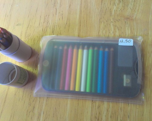 Cute tiny pack of colored pencils with sharpener and eraser, plus refill!
