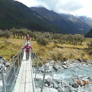 Small river swing bridge halfway to Aspiring DOC Hut