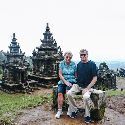 An adorable couple, Mr. and Mrs. Evans is taking picture in front of the Gedong Songo Temple Com