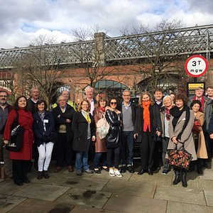 Twenty nationalities in Castlefield having a grand time on tour