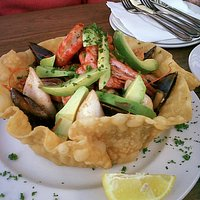 Try our signature seafood salad in a pizza basket