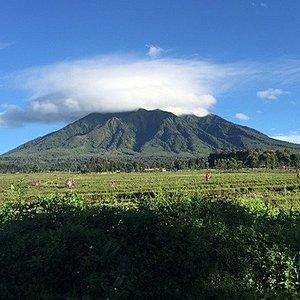 That is Muhabura mountain part of the Virunga Mountains that emerge from Congo to Rwanda and the