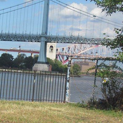 The Hell Gate Bridge behind the RFK Bridge. An Acela is on it's way to Boston