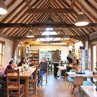Our cafe is warm and welcoming and our shop has lots of lovely local food and essentials