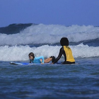 Surf Instructor Iskania teaches 7 year old Crystal the basics of a pop-up
