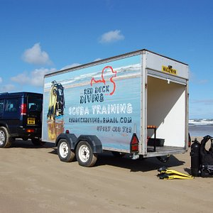 Our tailor-made scuba trailer is the ideal classroom, kit room and changing room.