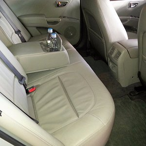 Our executive sedans have leather seats, dual zone A/C and bottled water. English speaking drive