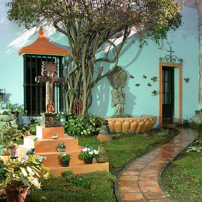 The folk art gallery is hosted at an old colonial house with a central patio and 5 surrounding h