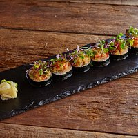 Ping Pong Roll: crispy spicy tuna, inari, chives, spicy mayo, pineapple salsa.