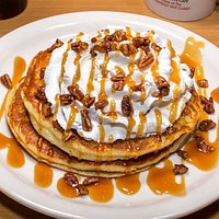 """""""Heavenly Hot Cakes"""" topped with caramel, pecans and whipped cream"""