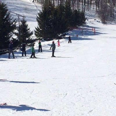beginning skiers using the two rope