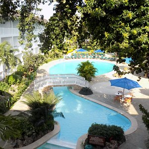 Travellers Beach Hotel.Bask,swim & slide in one of our beautiful swimming pools.