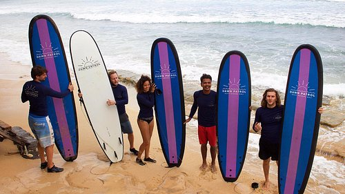 A group from Switzerland learning to surf with our Dawn Patrol Bali  at Balangan Beach Bali