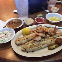 Grilled catfish with grilled shrimp. Sides of cole slaw, red beans & rice w/ a couple of hushpup
