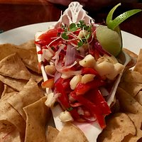 Shrimp ceviche on the half shell with superb chips with a flourish...