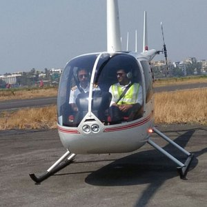 Helicopter ready to take off with 3 passengers on board