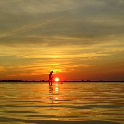 Paddle surf au Coucher du soleil