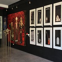 A glimpse inside the gallery at some of the artwork on display.