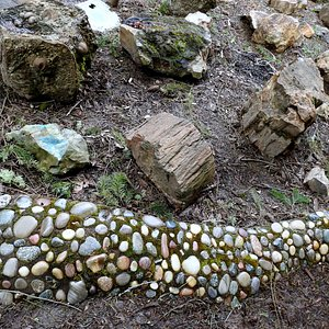 An outside display of stones collected from the flood deposites
