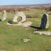 Men-an-tol ancient stone monument in a Penrith landscape.