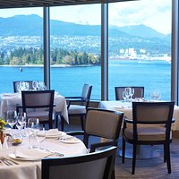 Breathtaking views of Vancouver's inner harbor, Stanley Park and local mountains.