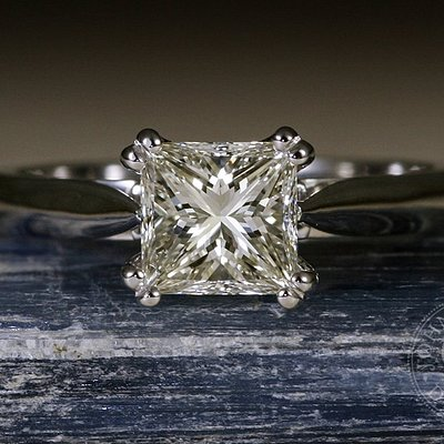 "John Miller Design - ""The One and Only"" - 18ct white gold featuring a Princess cut diamond"