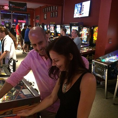 Couples enjoy the nightlife at Modern Pinball NYC.