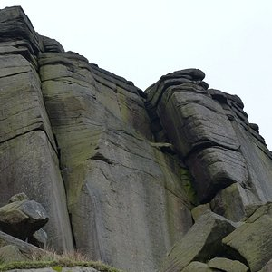 Looking up to Stanage Edge