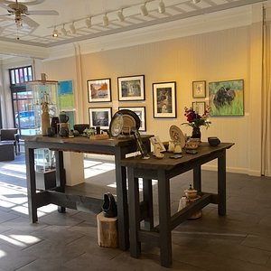 The gallery is located in a historic building that once was a grocery store.