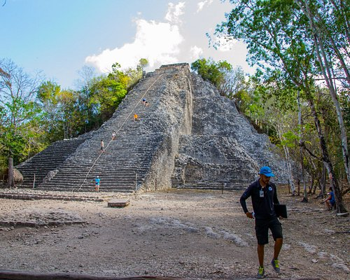 The pyramid at Coba with our awesome guide Joaquin.