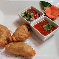 Curry Puffs with plum sauce.