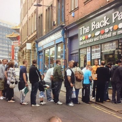 Fans queue to meet Tino Asprilla who scored a Champions League hat-trick for Newcastle v Barcelo