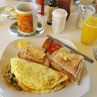 Mixed Callaloo and Spanish Omelette, Coffee and Orange Juice.