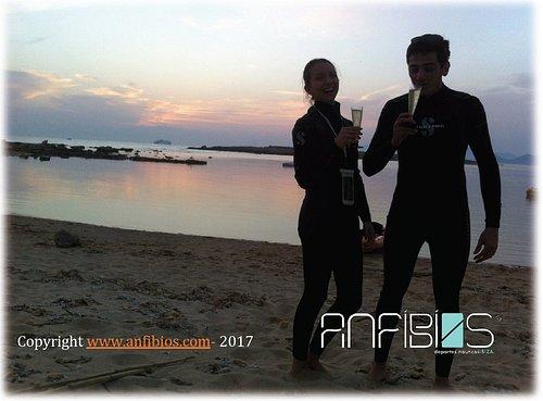 Enjoying the sunset after kayaking adventure. With anfibios Ibiza