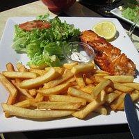 salmon steak, fries and salad