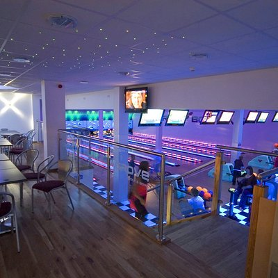 view from our bowling dining area of lanes under extreme lighting