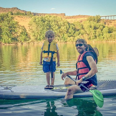 Enjoying an inflatable SUP board on the Snake River