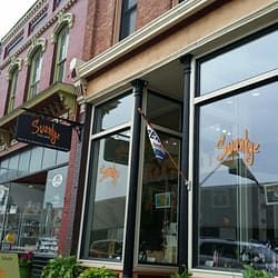 The outside of the store right downtown Manistee