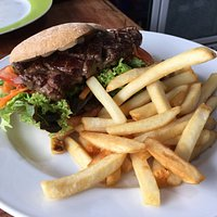 Our popular steak, onion and egg burger with fries on the side.