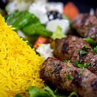 Beef Kofta- ground beef mixed with mild spices, served with rice and Greek salad