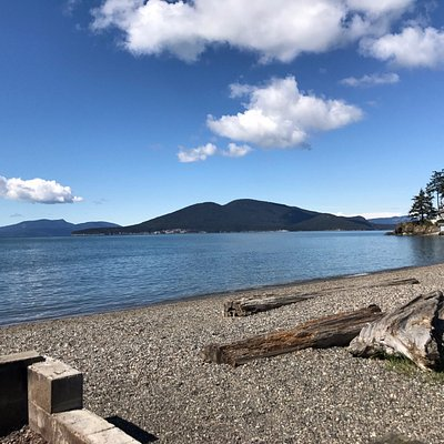 Looking across the Guemes Channel from the beach near the Washington Park boat launch on a sunny