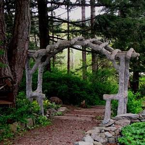 A path and arbor at the HCP gardens in Victoria, BC, Canada.
