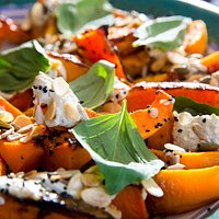 Roast butternut with burnt aubergine, yoghurt, toasted seeds and basil, ready for lunch