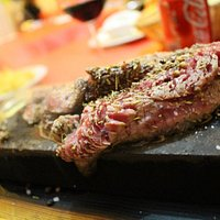 Steak cooked on the Azorean Lava Rock, crusted in spices