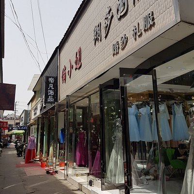 Typical smaller wedding dress shops along small alley