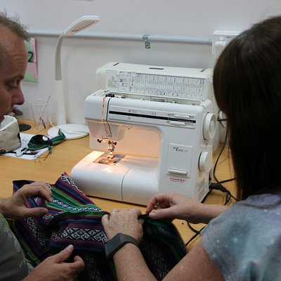 Sharon helping Tony with his sewing project