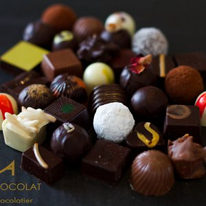 Assortment of hand-made chocolates with distinctive flavour pairings eg lavender and salted cara
