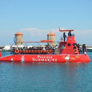 Poseidon semi submarine at mandraki harbor windmills