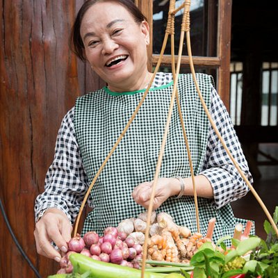 Smiling Pea with her basket of northern Thai ingredients