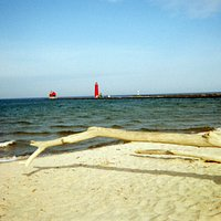 Lighthouse Beyond Grand Haven State Park's Sugary Beach